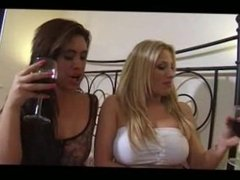 Two babes drinking their piss at a party.