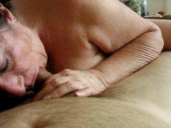 Brunette granny devouring a cock