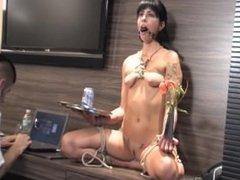 Beautiful bondage girl used as a decorative vase holder
