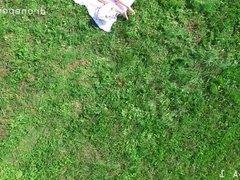 Nice girl masturbating on the grass