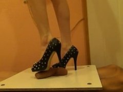 High heels on the table for cock and balls