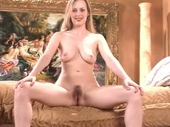 Gorgeous blonde with perfect tits spreads her pink pussy on a couch