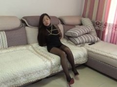 Bound on couch with vibrator