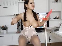 Brunette sucking a dildo on livespicycams-com