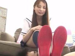 Japanese teen is pleasuring a horny guy with the smell of her sweaty feet