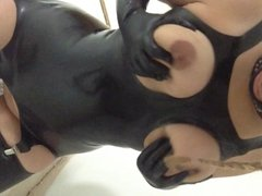 Latex slut wife milking her tits slave