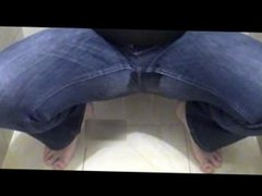 Crossdresser In Tight Blue Jeans Pissing