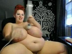 Redhead BBW with huge tits masturbates with vibrator on webcam