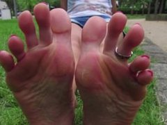 Girl shows her big soles and long toes