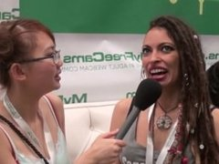 camgirl Exotica99 talks 2 Harriet Sugarcookie at MyFreecams booth AVN 2015