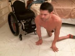 Naked paraplegic back bend