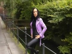 Fantastic brunette walking and smoking in leather