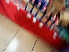 Hot milf in sportswear in the supermarket