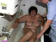 Nurse is bathing naked granny