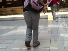Spanish girl walking through mall