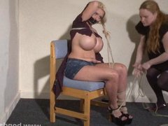 Lesbian bondage of Melanie Moon in tape gag
