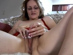Cute chubby chick in glasses fucks her soaking wet pussy