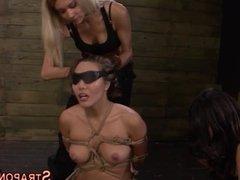 Blindfolded sub strapon