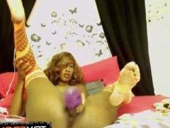 Inked ebony babe Nikki with hot lingerie plays