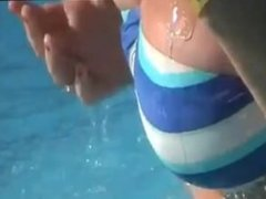 Tiny tits and ass exposed on the waterslide