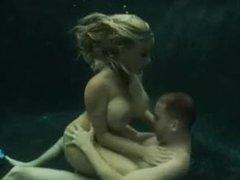 Big titted blonde fucks underwater