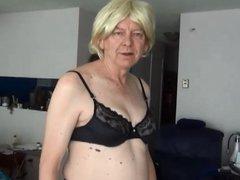 Naughty Gigi in fishnet tights and black bras