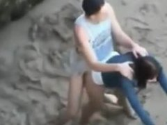 2 teens have sex on the beach
