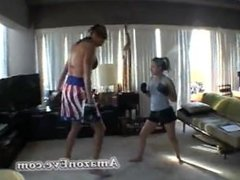 Tall amazon Eve giving boxing lessons too a small girl. Hot!!