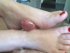 Sexy POV footjob and cumshot. Up close and personal with my wife's hot feet