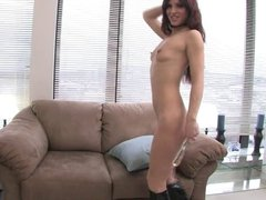 Sexy redhead in high boots penetrates her cunt with a toy
