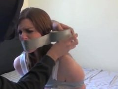 Girl taped up on the bed