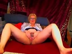 Blonde Granny Fingering Her Hairy Pussy