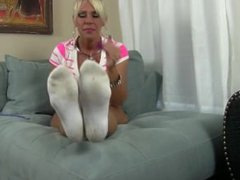 Blonde goddess put her dirty white champion socks on her feet