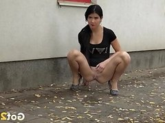Chick in a tight black dress pees in public