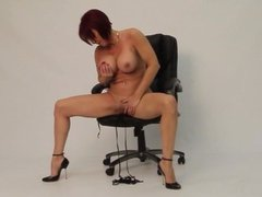 Audrey, on the chair, heels and gode