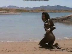 Bondage Brunette struggles to get out of quicksand