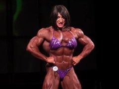 Christine Envall on stage hot posing and flexing