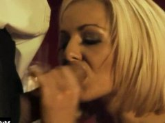 A blonde MILF with big boobs entices a well