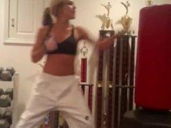 Karate girl hot workout on punching bag