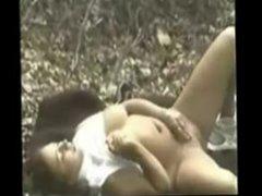 mature woman masturbating outdoors
