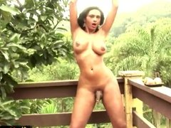 T-girl with massive boobs jerks off big dick in pink gloves