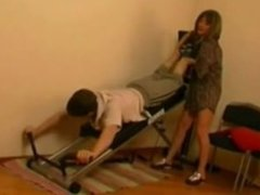 Mom helps boy workout