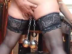 Big heavy balls hanging from pussy lips
