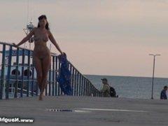 girl strolling nude in public