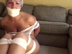 Nude balltied girl has her toes and feet tied