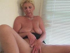 Dutch mature horny housewife masturbating