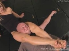 Sultry Blonde beats her pathetic husband with her legs