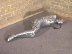 A redhead girl get black & duct tape mummified