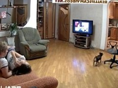 Reallifecam Leora and Paul in living room try to turn other on