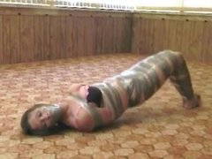 Tape mummified girl with bare feet taped